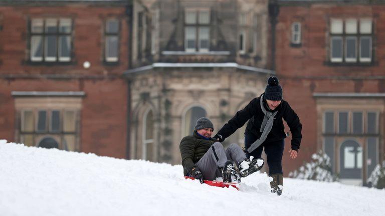 People enjoy the snow in Keele, Staffordshire, Britain, December 28, 2020. REUTERS/Carl Recine
