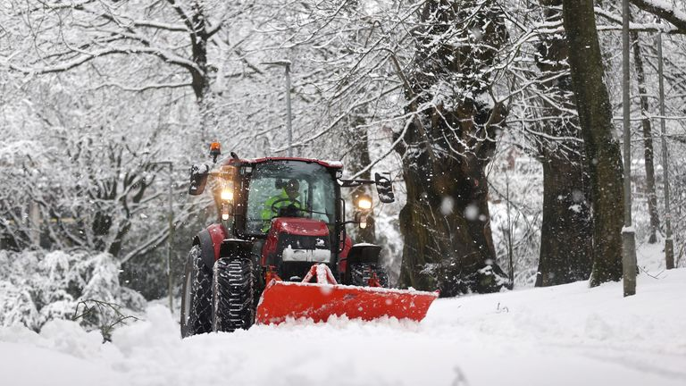 A snowplough drives down a road in Keele, Staffordshire, Britain, December 28, 2020. REUTERS/Carl Recine