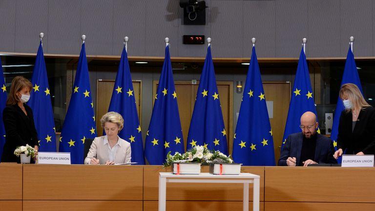 Ursula von der Leyen and Charles Michel sign the deal in Brussels