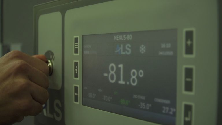 An industrial refrigerator showing -81.8 degrees Celsius is seen at the Angelantoni Life Science (ALS) factory, an Umbrian company specialising in building medical and industrial fridges and is working on providing a solution to the transportation of the coronavirus disease (COVID-19) vaccines, in Massa Martana, Italy, in this still image taken from video, November 24, 2020. Picture taken November 24, 2020. REUTERS TV via REUTERS