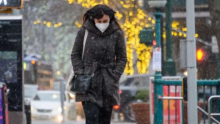 A person wears a face mask on the Upper West Side during a snow storm on December 16, 2020 in New York City.