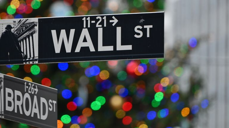 Wall Street sign at the New York Stock Exchange (NYSE) on December 9, 2020 in New York City.