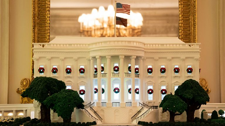 Gingerbread White House displayed in the state dining room