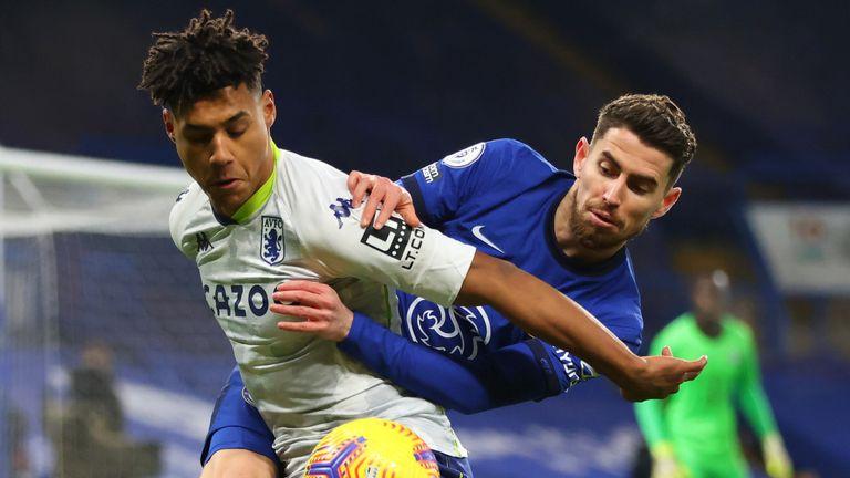 Jorginho and Ollie Watkins battle for possession