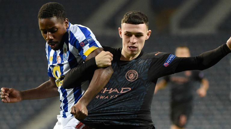 Phil Foden tangles with Porto's Wilson Manafa