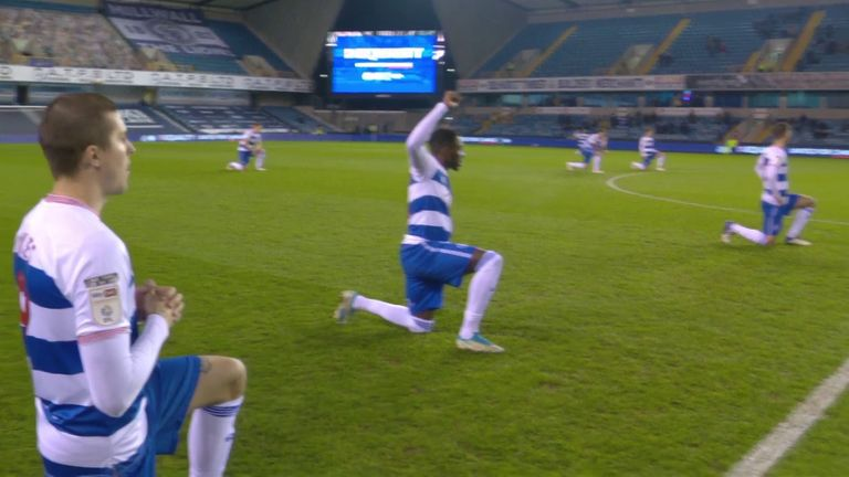 QPR players take a knee ahead of their Championship match against Millwall.