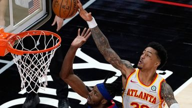Collins' big rejection saves game for Hawks