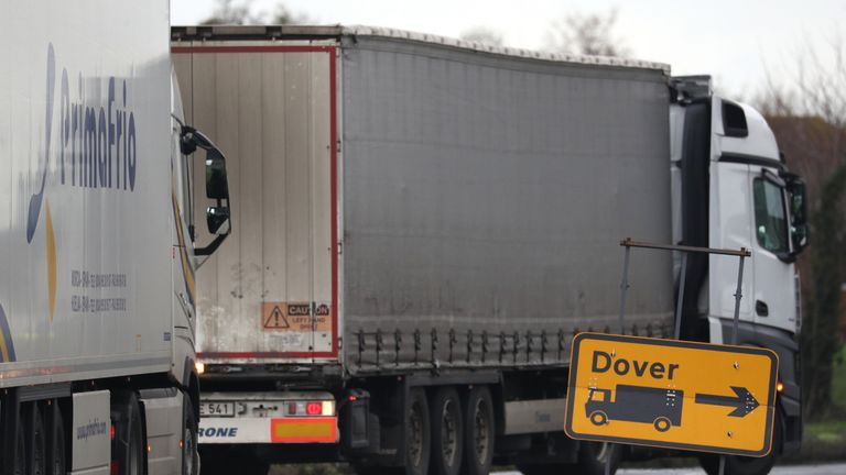 A lorry passes a Dover sign as it makes it's way into the lorry park at Manston Airport, Kent, after France imposed a 48-hour ban on entry from the UK in the wake of concerns over the spread of a new strain of coronavirus.