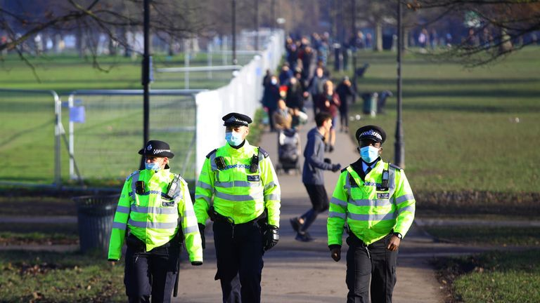 Police presence before a proposed anti-lockdown protest in Clapham Common, London.