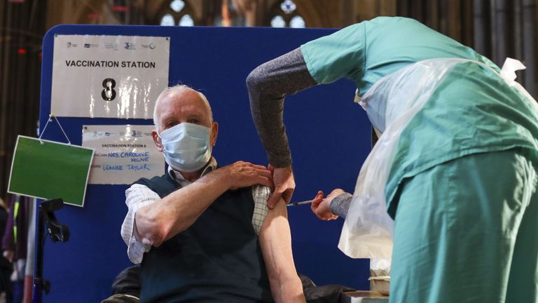 Former RAF Flight Sergeant Louis Godwin receives an injection of the Pfizer coronavirus vaccine at Salisbury Cathedral, Wiltshire.