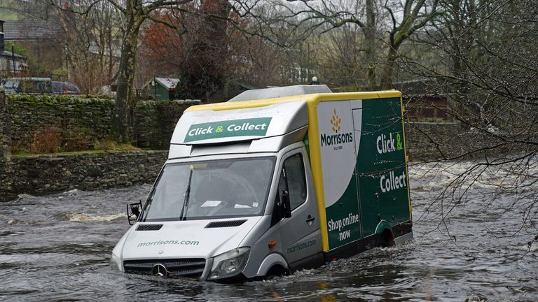 Supermarket delivery van in the River Wear at Westgate, County Durham, the driver was rescued on Tuesday evening by the Water Rescue Team of the Durham and Darlington Fire and Rescue Service from the top of his van after it was swept away while apparently crossing a ford on the evening of Tuesday January 19. Picture date: Wednesday January 20, 2021.