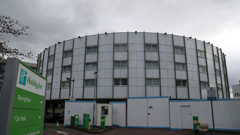 A fence surrounds the Holiday Inn hotel near Heathrow Airport in London, which has been reserved by the Government for people arriving from abroad to self-isolate.