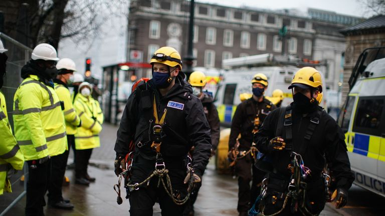 Police officers wearing climbing equipment move in to the encampment in Euston Square Gardens in central London, where HS2 Rebellion protesters have built a 100ft tunnel network, which they are ready to occupy, after claiming the garden is at risk from the HS2 line development. Picture date: Wednesday January 27, 2021.