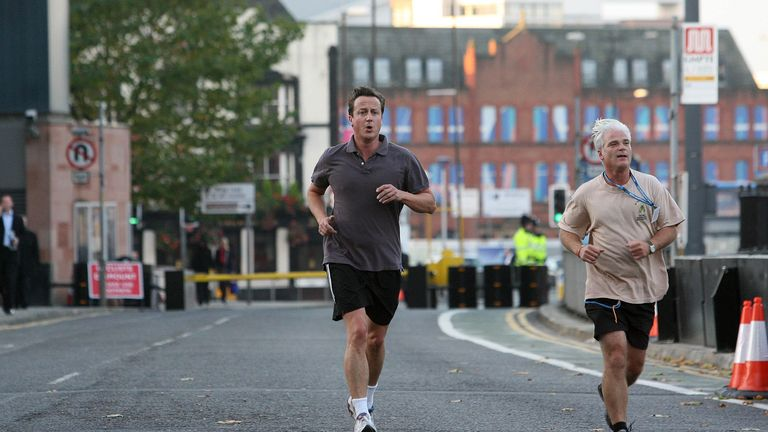 Conservative party leader David Cameron (left) goes for an early morning run with MP Desmond Swayne ahead of his speech at his party's conference in Manchester.