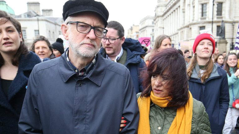 Labour leader Jeremy Corbyn and his wife wife Laura Alvarez during the International Women's Day march in central London.