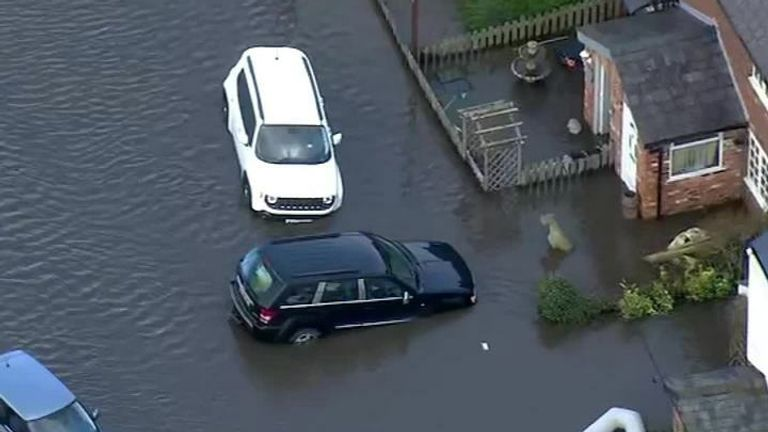 Cars afloat in flooding caused by Storm Christoph