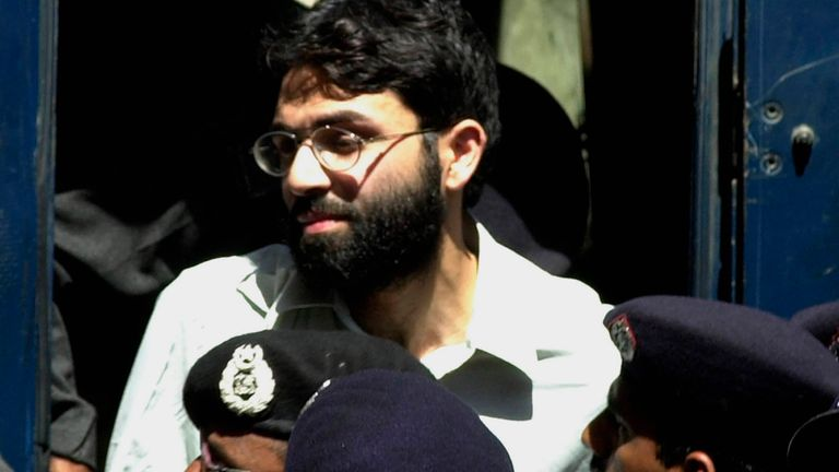 FILE - In this March 29, 2002 file photo, Ahmed Omar Saeed Sheikh, the alleged mastermind behind Wall Street Journal reporter Daniel Pearl's kidnap-slaying, appears at the court in Karachi, Pakistan. The U.S. on Wednesday, Dec. 30, 2020, warned it won't allow the Pakistani Sheikh to evade justice after a provincial Pakistani court ordered his release. (AP Photo/Zia Mazhar, File)