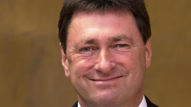 Britain's favourite gardener Alan Titchmarsh poses for photographers after receiving an MBE for services to horticulture and broadcasting from Britain's Queen Elizabeth II at Buckingham Palace in London June 6 2000.