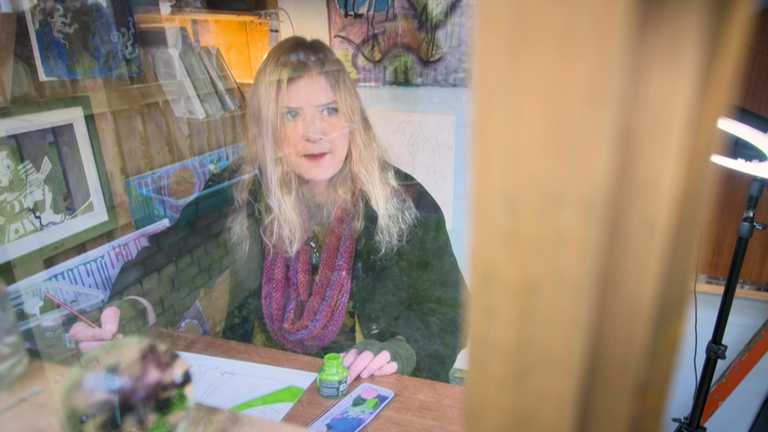 Most days Alice sits and paints in a small timber shed at the bottom of her garden