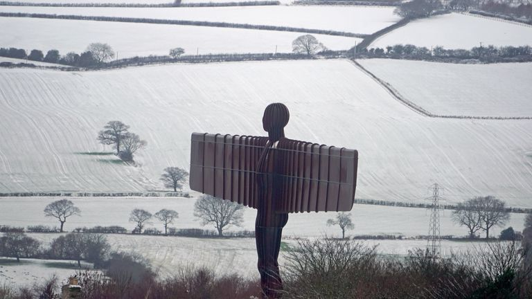The Angel of the North surrounded by fields covered with snow near Gateshead, Tyne and Wear.