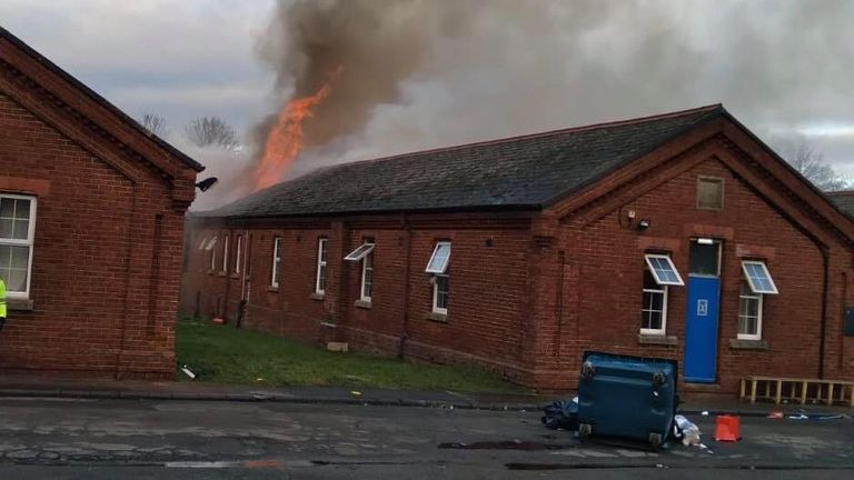 The fire broke out at the former barracks which is home to hundreds of asylum seekers