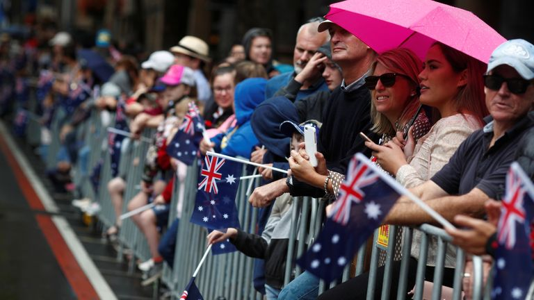 People watch contingents march past during an Anzac Day parade in Sydney People watch contingents march past during an Anzac Day parade in Sydney, Australia April 25, 2018. REUTERS/Edgar Su