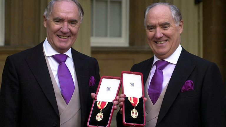 Sir David Barclay (l) and his twin brother Sir Frederick after receiving their knighthoods at Buckingham Palace in 2000