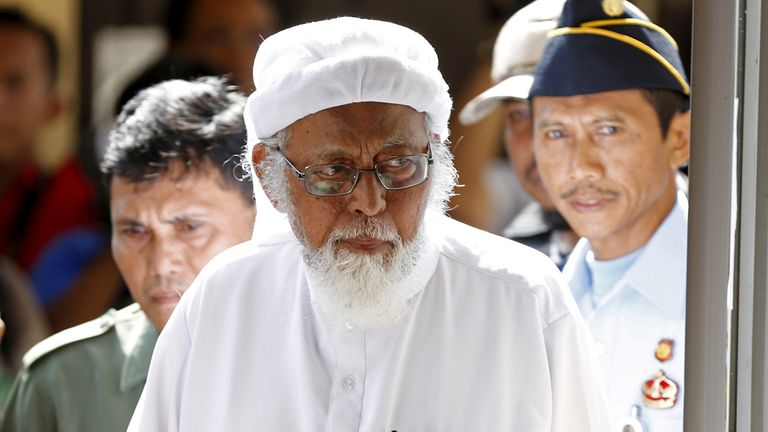 Indonesian radical Muslim cleric Abu Bakar Bashir enters a courtroom for the first day of an appeal hearing in Cilacap, Central Java province