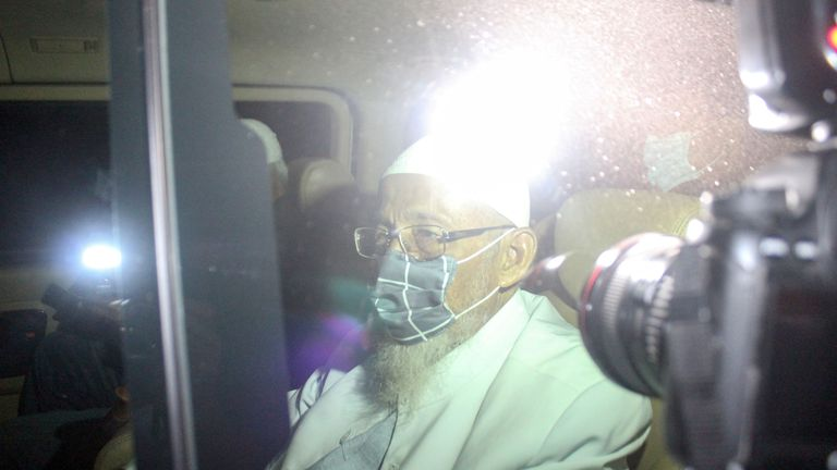 Abu Bakar Bashir is seen inside a car as he is released from prison in Bogor