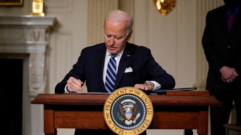 President Joe Biden signs an executive order on climate change. Pic: AP