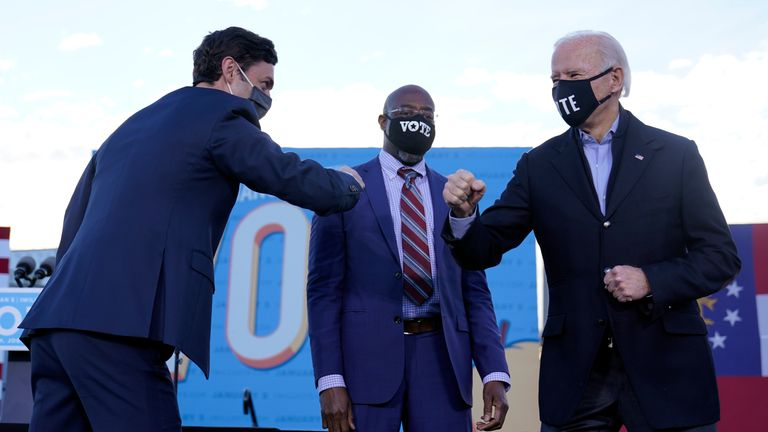 Joe Biden (R) campaigns for Senate candidates Raphael Warnock (C) and Jon Ossoff (L)