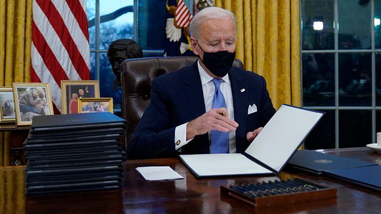 President Biden signing executive orders Pic: AP