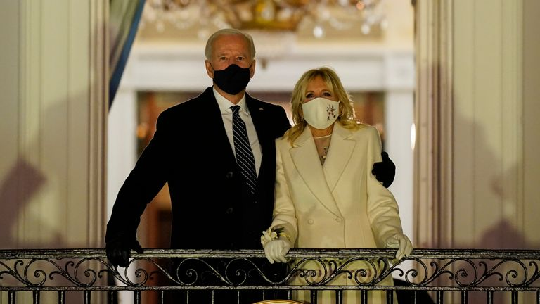 Joe Biden with his wife Jill on the Blue Room Balcony at the White House Pic: AP