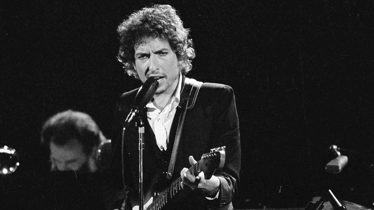 Bob Dylan performs with The Band at the Forum in Los Angeles in 1974