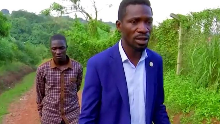 Bobi Wine with the security guard he claims was attacked