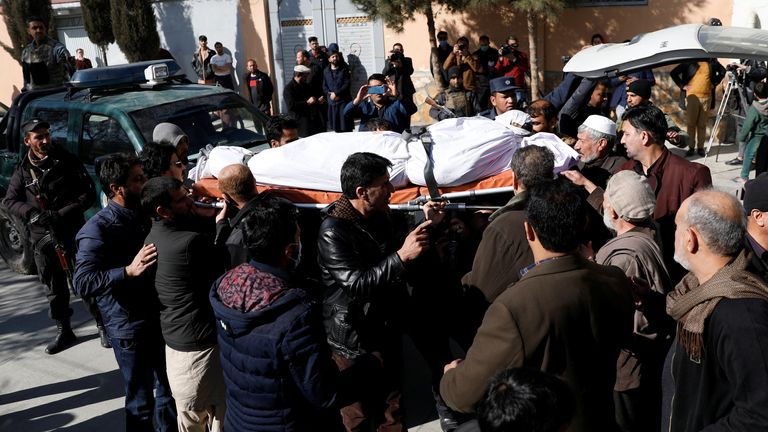 Relatives carry the body of one of the female judges