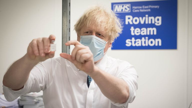 Prime Minister Boris Johnson sees how a dose of the Oxford/Astra Zeneca Covid 19 vaccine is prepared for a mobile vaccination centre at Barnet FC's ground at The Hive, north London, which is being used as a coronavirus vaccination centre. Picture date: Monday January 25, 2021
