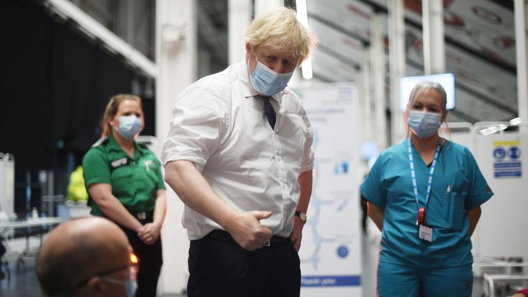 Britain's Prime Minister Boris Johnson visits a COVID-19 vaccination centre at Ashton Stadium in Bristol
