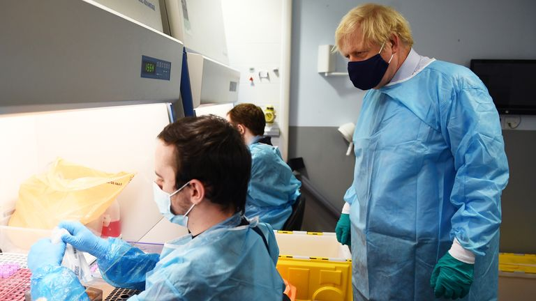Mr Johnson watched technicians processing PCR samples at Queen Elizabeth Hospital in Glasgow