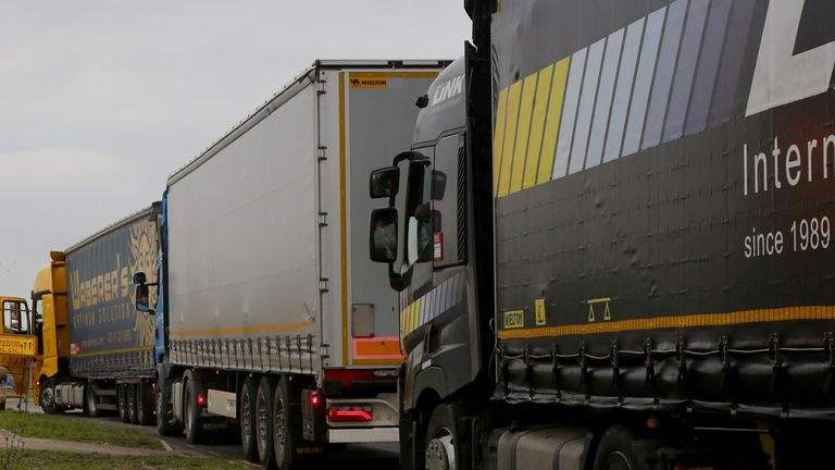Lorries queue for a customs facility in Ashford, Kent, as Channel traffic builds up following a quiet start to the year and the end of the transition period with the European Union on December 31.