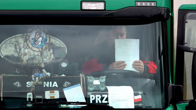 A lorry driver checks his paperwork after being processed at a customs facility in Ashford, Kent, as Channel traffic builds up following a quiet start to the year and the end of the transition period with the European Union on December 31