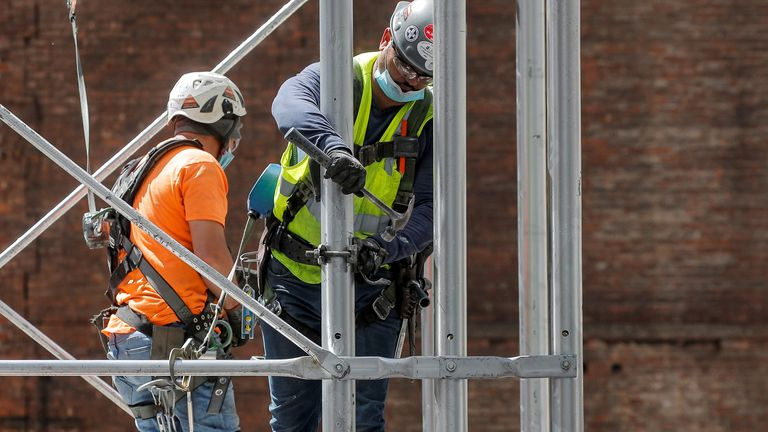Construction workers assemble a scaffold at a job site, as phase one of reopening after lockdown begins, during the outbreak of the coronavirus disease (COVID-19) in New York City, New York, U.S., June 8, 2020