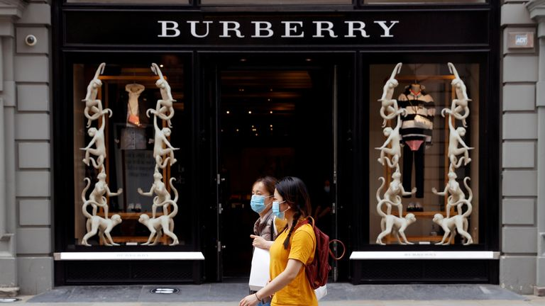 People wearing protective masks walk past a Burberry store at Covent Garden, following the outbreak of the coronavirus disease (COVID-19) in London, Britain June 15, 2020.