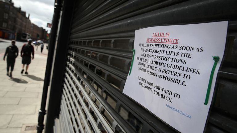 A sign on the shutters of a business premises in Edinburgh as the UK continues in lockdown to help curb the spread of the coronavirus