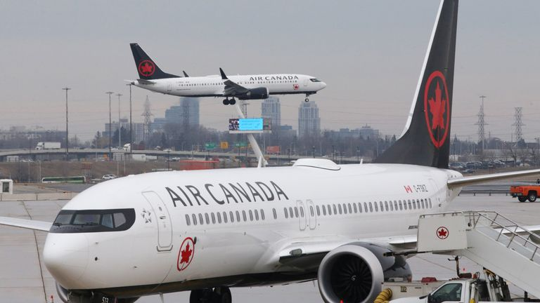 An Air Canada Boeing 737 MAX 8 from San Francisco approaches for landing at Toronto Pearson International Airport over a parked Air Canada Boeing 737 MAX 8 aircraft in Toronto, Ontario, Canada, March 13, 2019