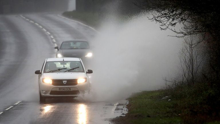Cars travelling through standing water near Canterbury