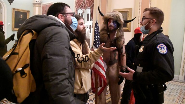 Police confront supporters of President Donald Trump as they demonstrate on the second floor of the U.S. Capitol near the entrance to the Senate after breaching security defenses, in Washington, U.S., January 6, 2021. REUTERS/Mike Theiler