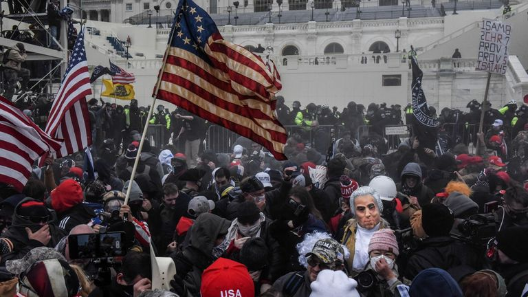 "Supporters of U.S. President Donald Trump face off with police during a ""Stop the Steal"" protest outside of the Capitol building in Washington D.C. U.S. January 6, 2021. Picture taken January 6, 2021. REUTERS/Stephanie Keith"
