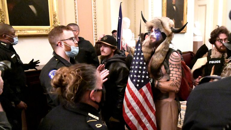 Police confront supporters of President Donald Trump inside the Capitol building