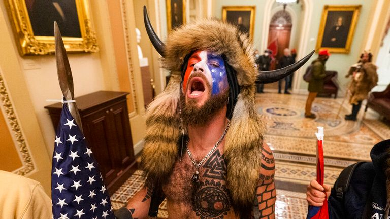 A supporter of President Donald Trump chants outside the Senate Gallery inside the Capitol